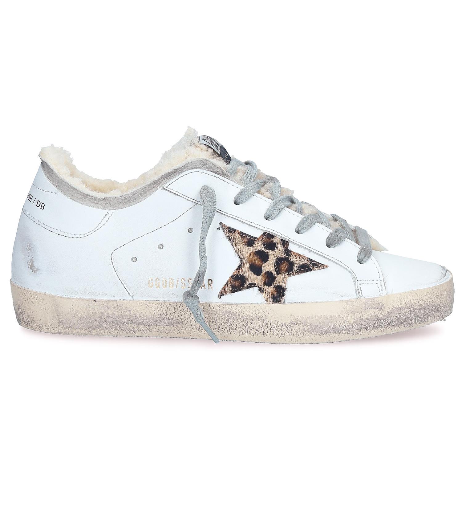 Sneakers Superstar blanches en shearling et étoile léopard